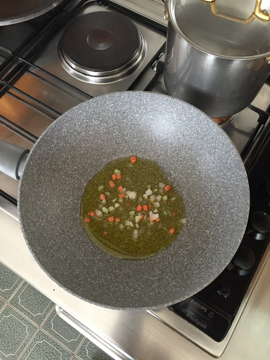 place the oil with some chopped carrot and onion in a saucepan
